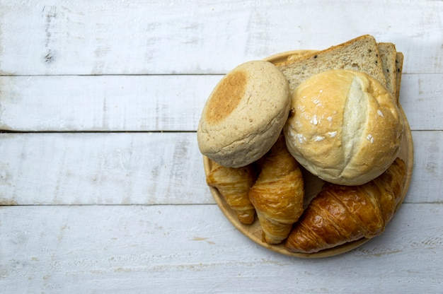 Top view of fresh bread on wooden table