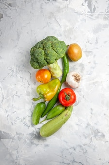 Top view fresh broccoli with vegetables on white table salad ripe health diet