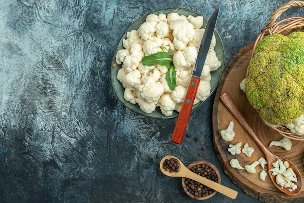Top view fresh cauliflower inside basket on a light-grey table