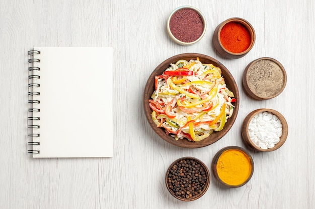 Top view fresh chicken salad with seasonings on the white desk snack meal meat fresh salad