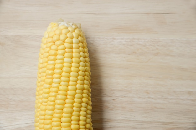Top view of fresh corn on the wood table
