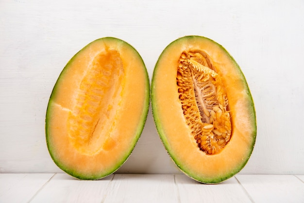Top view of fresh and delicious cantaloupe melon slices on white