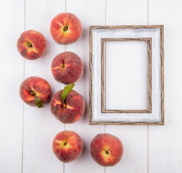 Top view of fresh and delicious peaches isolated on white with copy space