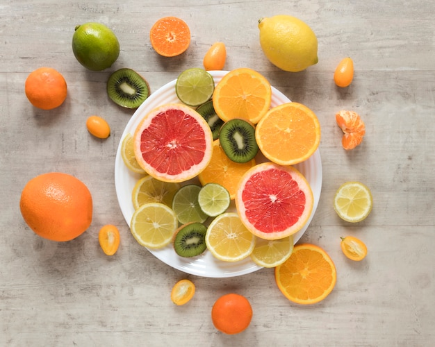 Top view fresh and exotic fruits on a plate