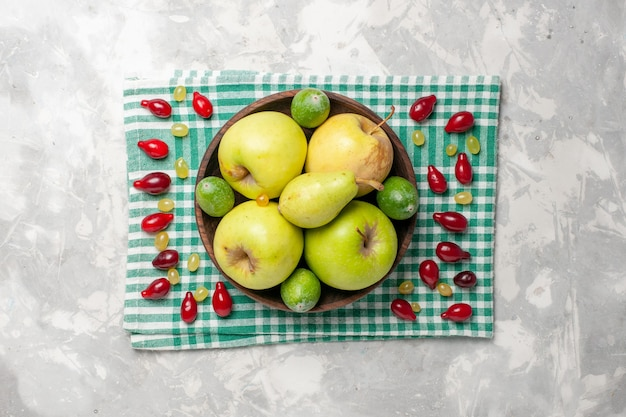 Top view fresh fruits apples pears and feijoa on white desk