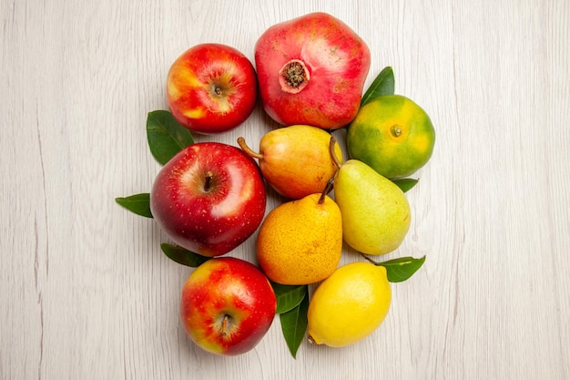 Top view fresh fruits apples pears and other fruits on white desk fruits ripe tree color mellow many fresh