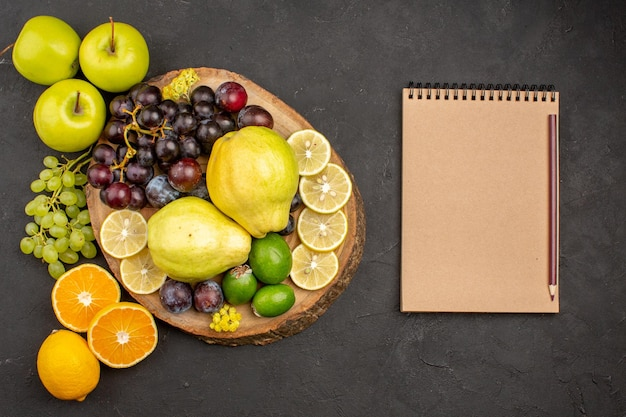 Top view fresh fruits composition mellow and ripe fruits on dark background fruit ripe mellow health fresh