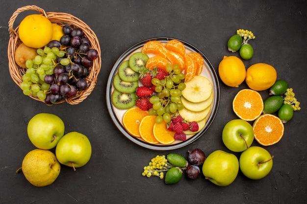 上面図新鮮な果物の組成暗い机の上の熟した果物果物まろやかな新鮮なビタミン熟した