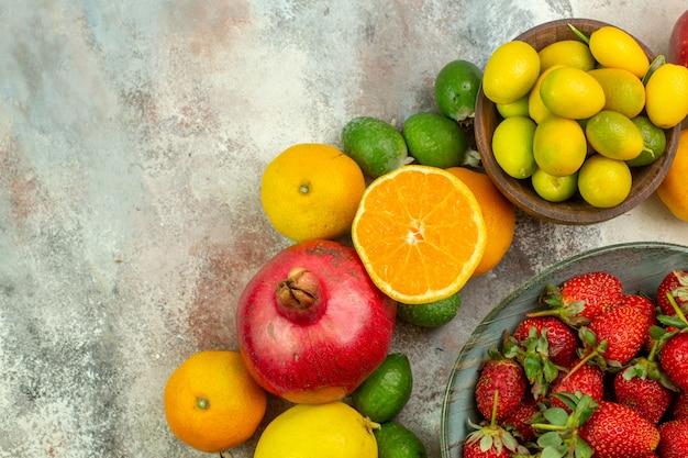 上面図新鮮な果物白い背景のさまざまなまろやかな果物健康ツリー色おいしい写真ベリー柑橘類熟した
