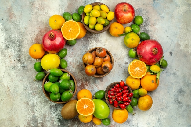 Top view fresh fruits different mellow fruits on white background health tree color  ripe berry citrus