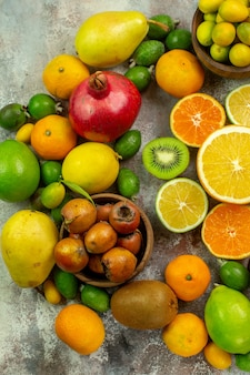 Top view fresh fruits different mellow fruits on the white background tree tasty  ripe diet color health berry citrus