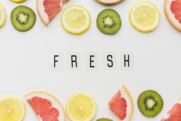 Top view of fresh fruits with copy space