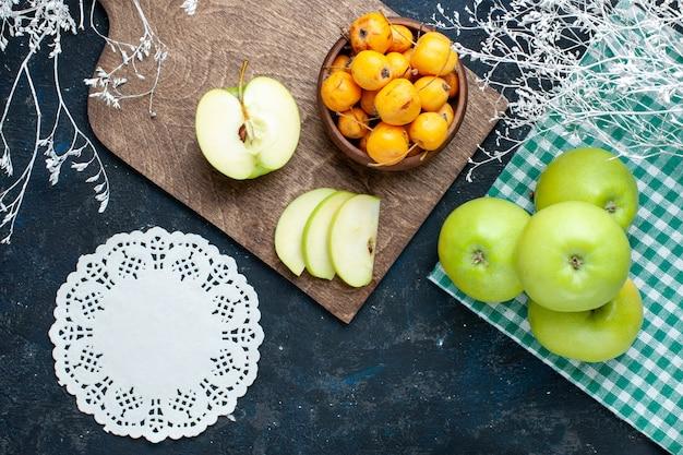 Top view of fresh green apples with sweet mellow cherries on dark desk, fruit fresh mellow food vitamine