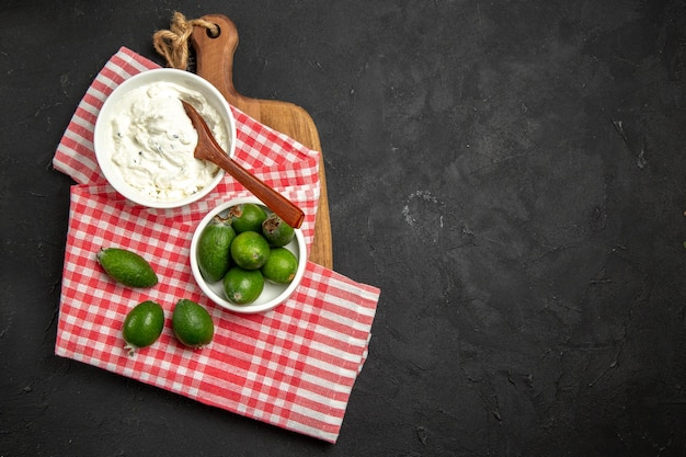 Top view fresh green feijoa with cream on a dark surface fruit exotic health mellowa