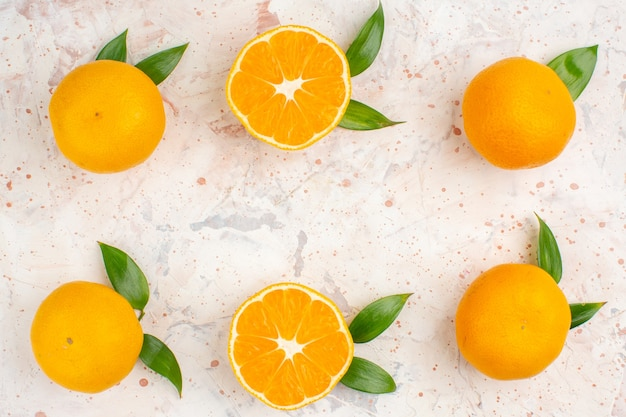 Top view fresh mandarines cut mandarines on bright isolated surface with copy space