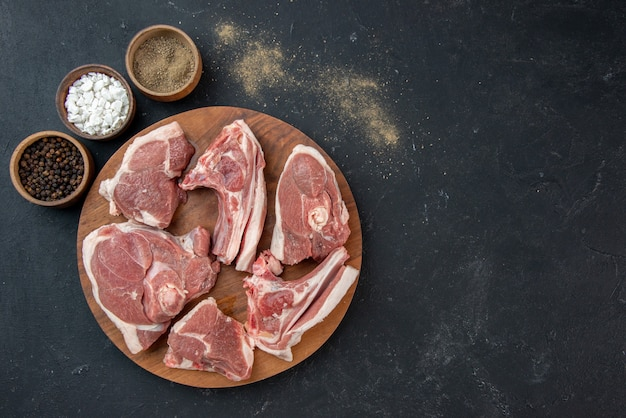 Top view fresh meat slices raw meat on dark meal food freshness cow food kitchen animal