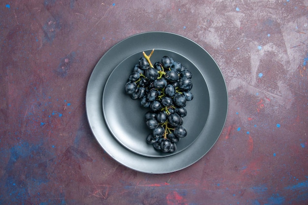 Top view fresh mellow grapes dark fruits inside plate on a dark surface wine fresh grape fruit tree plant ripe