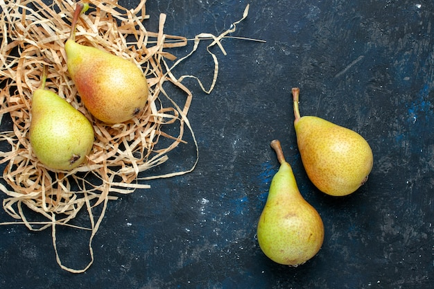 Top view of fresh mellow pears whole ripe and sweet fruits on dark-grey desk, fruit mellow food health