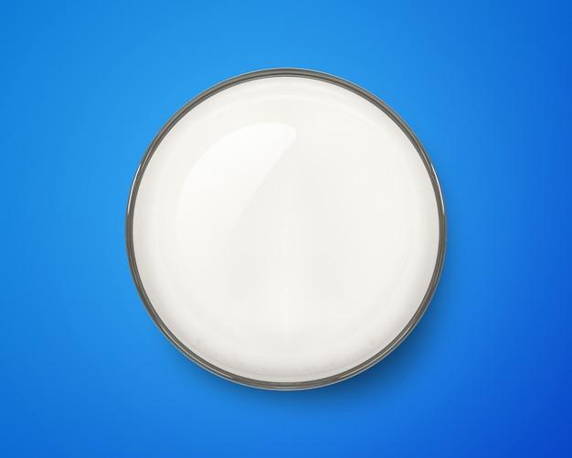 Top view of fresh milk glass on blue background. breakfast drink.