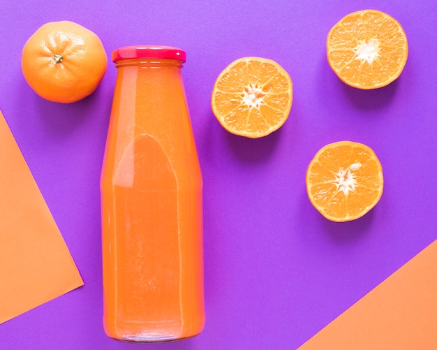 Top view fresh orange smoothie in bottle