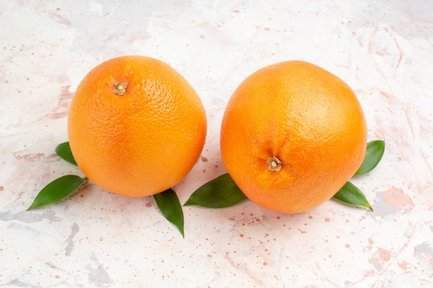 Top view fresh oranges on bright isolated surface