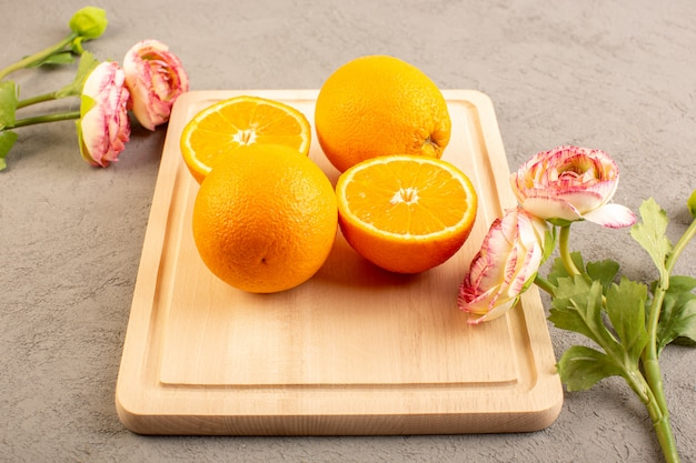 A top view fresh oranges sour ripe sliced and whole mellow citrus juicy tropical vitamine yellow on the cream desk