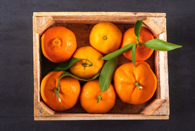Top view fresh oranges in wooden box