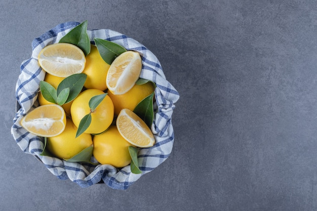 Top view of fresh organic lemons and slices.