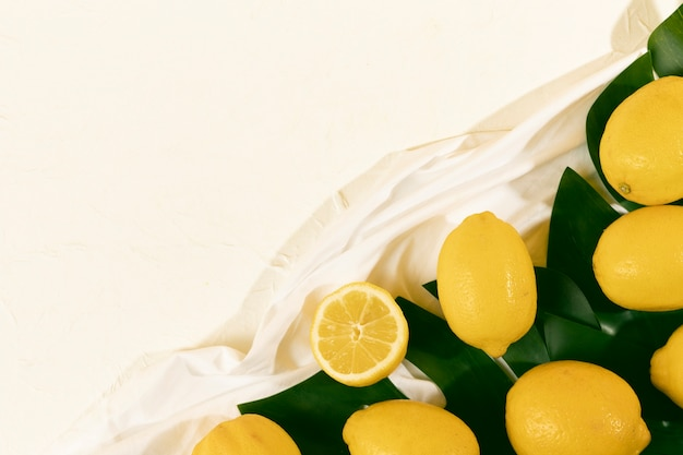 Top view fresh organic lemons on table
