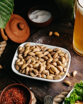 A top view fresh peanuts with green salad on the wooden desk snack nut photo
