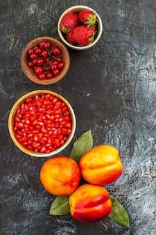 Top view of fresh peeled pomegranates with peaches