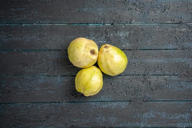 Top view fresh quinces mellow and sour fruits on dark blue desk ripe fetus fresh tree sour plant