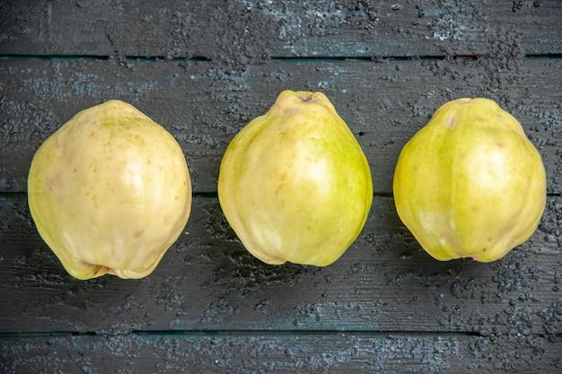 Top view fresh quinces mellow and sour fruits on dark desk ripe fetus fresh tree sour plant