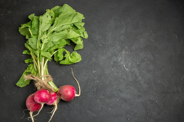 Top view of fresh radish with green leaves