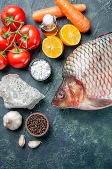 Top view fresh raw fish dark blue background