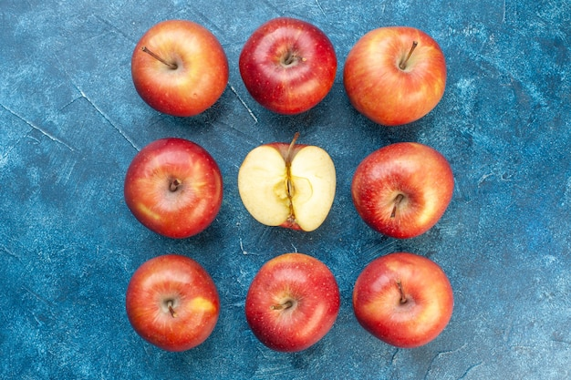 Top view fresh red apples lined on blue table photo ripe color tree fruit healthy life pear
