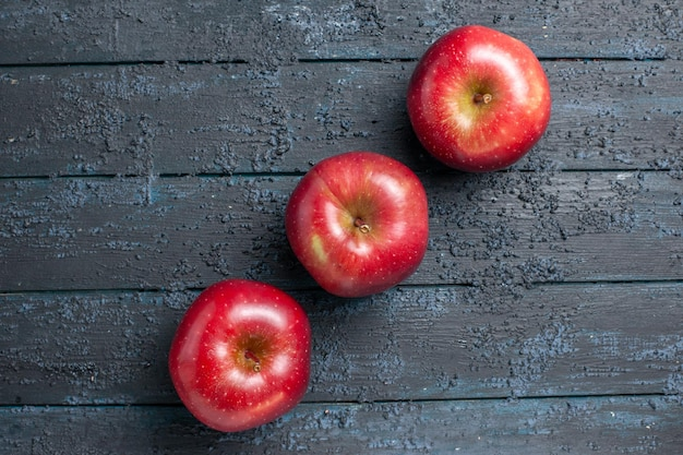 Top view fresh red apples ripe and mellow fruits lined on dark-blue desk many fruit red fresh plant color tree