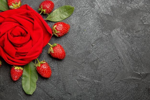 Top view fresh red strawberries on dark floor fruit berry ripe color