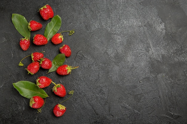 Top view fresh red strawberries on dark grey table berry ripe fruit color