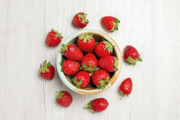 Top view fresh red strawberries on white desk