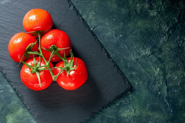 Top view fresh red tomatoes on a dark surface grow meal food dinner tree ripe color salad photo