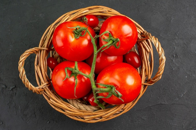 Top view fresh red tomatoes inside basket