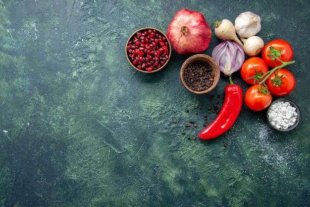 Top view fresh red tomatoes with garlic and seasonings on dark blue background pepper vegetable food salad