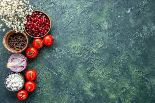Top view fresh red tomatoes with seasonings on dark background health meal salad food color photo diet free space