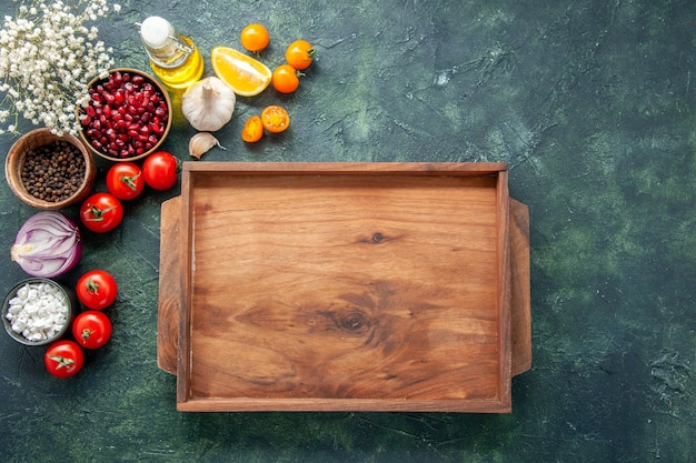 Top view fresh red tomatoes with wooden desk on dark background health meal salad food color photo diet free space