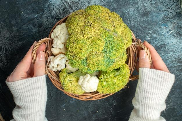 Top view fresh ripe cauliflower inside basket on light-grey desk