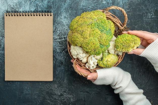 Top view fresh ripe cauliflower inside basket on light-grey tabl