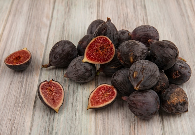 Top view of fresh ripe dark skinned mission figs isolated on a grey wooden background