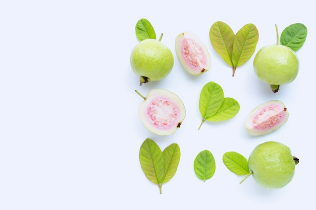 Top view of fresh ripe guava and slices with leaves