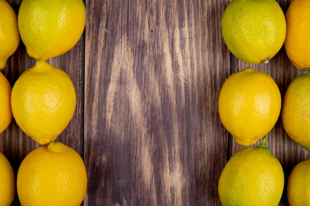 Top view of fresh ripe lemons isolated on rustic surface with copy space